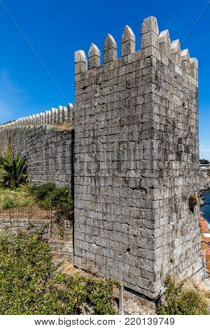 Rectangular watchtowers of the medieval castle called Fernandina Wall located in Porto, Portugal. Construction started in 1336 by King D. Afonso IV and completed in 1376 by King D. Fernando.