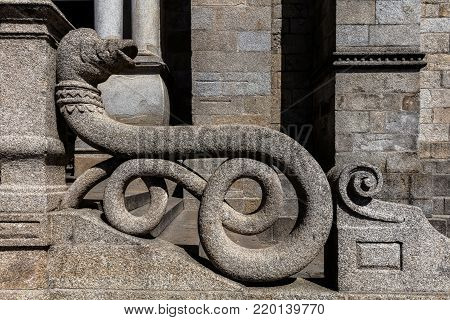 Medieval stone snake balustrade of the Porto cathedral in Porto, Portugal