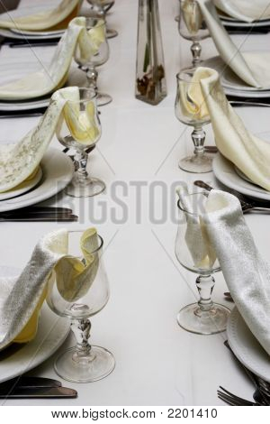 Lines Of Glasses With Napkins At Restaurant