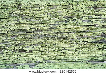 Corroded green - blue metal background. Rusty green painted metal walls. Rusty metal background with streaks of rust. The rust spots, texture
