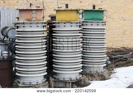 Closeup of high voltage insulators deferred for storage