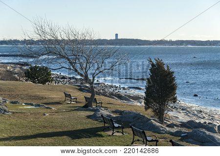 Winter day on rocky shoreline at Fort Phoenix in Fairhaven, Massachusetts