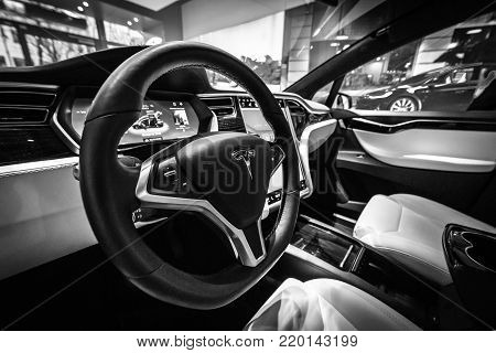 BERLIN - DECEMBER 21, 2017: Showroom. Interior of the full-sized, all-electric, luxury, crossover SUV Tesla Model X. Produced since 2016. Black and white.