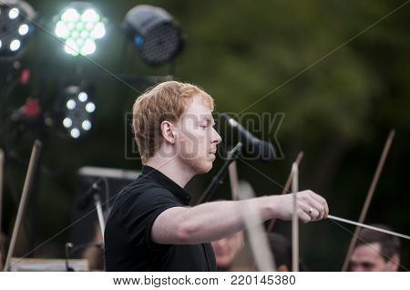 ROSTOV-ON-DON, RUSSIA - 10 SEPTEMBER 2017. Performance of the Rostov Academic Symphony Orchestra on the Public Library site. The conductor of orchestra. Matvienko Dmitry.