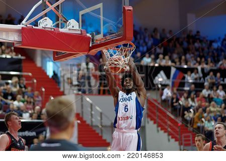 ST. PETERSBURG, RUSSIA - AUGUST 6, 2017: Shawn Dawson, Israel scores in the basketball match Russia (black) vs Israel (white) for Kondrashin-Belov Cup. Israel won 79-71