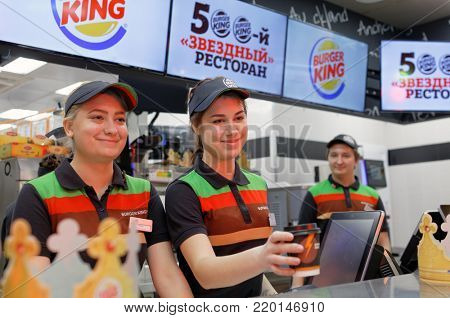 ST. PETERSBURG, RUSSIA - NOVEMBER 29, 2017: Staff of 500th Burger King restaurant in Russia in the service area in the day of opening. First Burger King restaurant opened in Russia  2010