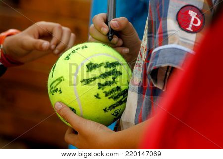 BARCELONA, SPAIN - APRIL, 22: Tennis player signing an autograph to tennis fans during a Barcelona tennis tournament Conde de Godo on April 22, 2015 in Barcelona Spain