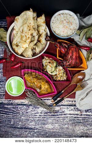 Handmade Indian food chicken tandoori and Tikka with garlic naan