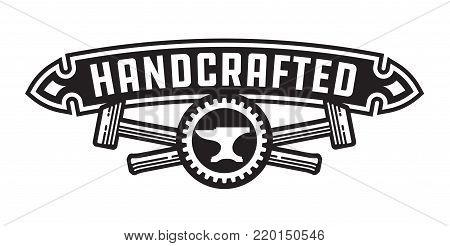 Handcrafted design or badge with hammers Vector design featuring, crossed hammers, cog and anvil with handcrafted banner.