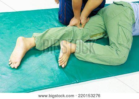 student education coaching massage finger the press on leg ( Traditional massage Thai medicine)