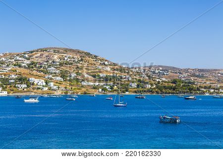Greece. Cyclades. Paros island. Picturesque white houses near Parikia town. Yachts and boats in the sea