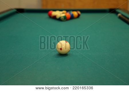 Playing billiards / Details / Billiard balls on green table