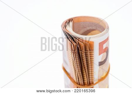 A roll with fifty euro banknotes on white background