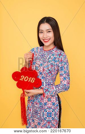Vietnamese woman traditional festival costume Ao Dai holding attributes. Text mean Happiness. poster