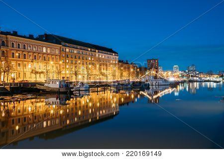 Helsinki, Finland. View Of Pier With Boats And Pohjoisranta Street In Evening Night Illuminations.