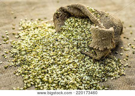 Split Green Gram,moong Dal,vigna Radiata Coming Out From A Gunny Bag.;
