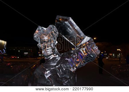 Bust of Ilya Muromets the sword on the exhibition of ice sculptures