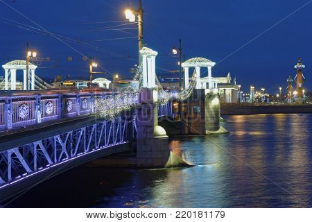 ST. PETERSBURG, RUSSIA - DECEMBER 18, 2017: Palace bridge across Neva river decorated for Christmas. Christmas street decorations comprise of 2606 garlands and light elements
