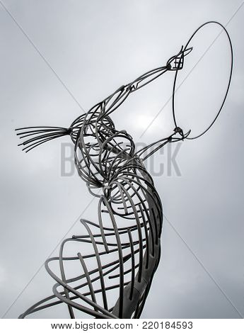 Beacon of Hope - The sculpture is the result of six years of planning, development and eventual fabrication. Made of stainless steel and cast bronze, she spirals upwards and holds aloft