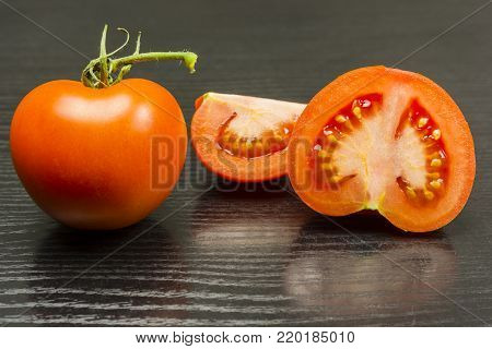 Cross-section and full view of a hothouse (greenhouse-grown) tomato.
