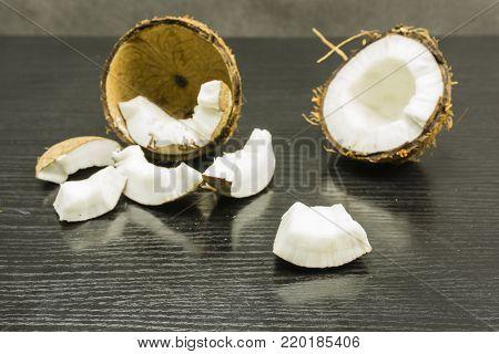 White edible part of the split coconut fruit (Cocos nucifera).
