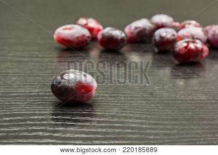 Fruit of red grape on the table.