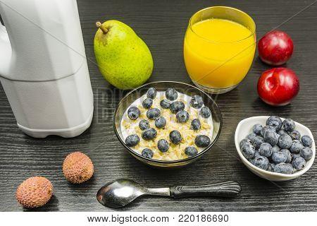 Healthy breakfast set. Porridge with milk, fruit and orange juice.