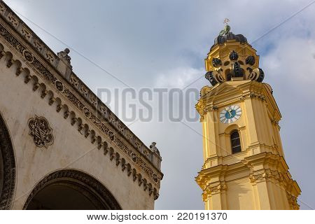 feldherrnhalle and tower of theatinerkirche theatinerchurch at odeon square odeonplatz in munich city bavaria germany tower clock time detail landscape orientation