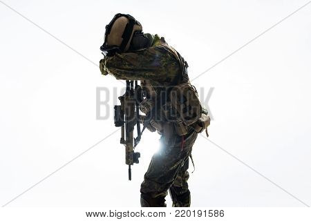Defender shutting appearance by arm while keeping assault rifle. Camouflage concept. Isolated