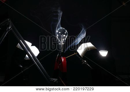 Lightbulb with smoke showing aerodynamics also suitable as a background