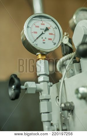 Factory Worker Adjusts The Control Panel Of Industry Machine