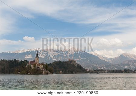 View On Bled Lake, Island, Church And Castle With Mountain Range (Stol, Vrtaca, Begunjscica) In The Background Bled, Slovenia, Europe