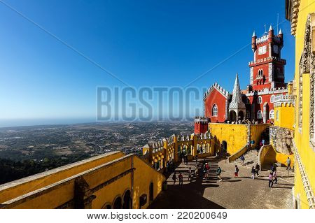 Sintra, Portugal, August 8, 2017: The Arches Yard, chapel and clock tower of the Pena Palace, a Romanticist castle, a UNESCO World Heritage Site and one of the Seven Wonders of Portugal.