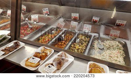 Honolulu - June 6, 2016: Fresh Fish, Ahi, Tuna, Poke and ready to eat products, Sushi, potatoes, garlic soy beans on display at Tamashiro Fish Market