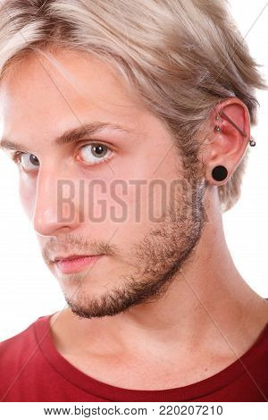 Stylish teenage boy close portrait fashionable hairstyle and pierced ear - black plug, industrial and rook pierce, isolated on white