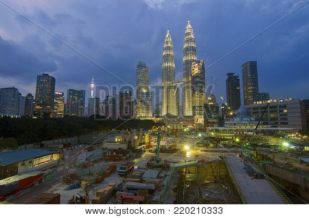KUALA LUMPUR, Malaysia - November 11,2017. Kuala Lumpur Twin Tower are seen on the left of the under construction building