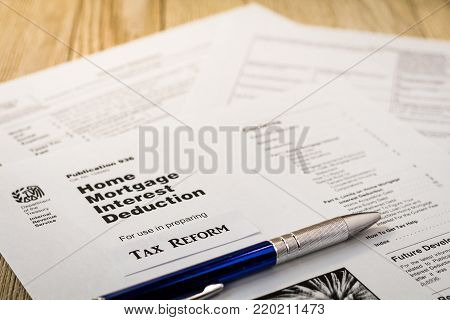 Tax reform concept with tax preparation forms for home mortgage interest deductions