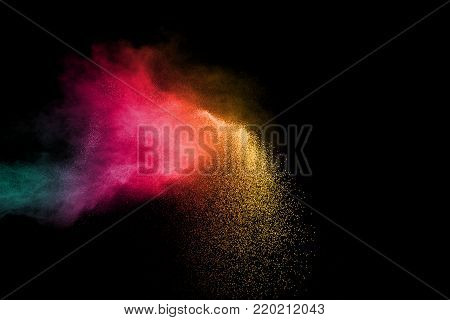 abstract color powder explosion on black background.abstract  Freeze motion of color dust or particles splash.