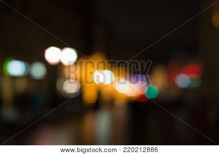 Colorful street lights background on dark, out of focus lights during the night