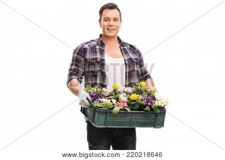 Gardener holding a crate filled with flowers isolated on white background