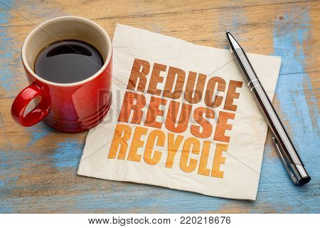 reduce, reuse, recycle  word abstract on a napkin with a cup of coffee - resources conservation concept