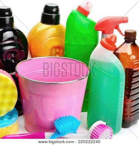 Set of household chemicals, bucket and brushes for cleaning isolated on white background.