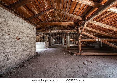 Creepy attic interior at abandoned industrial building