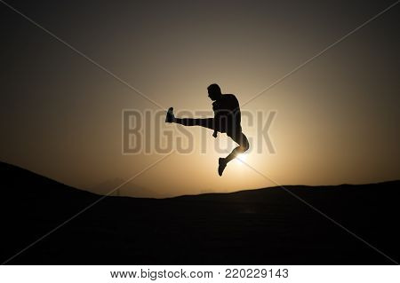 Athlete With Muscular Body In Dusk