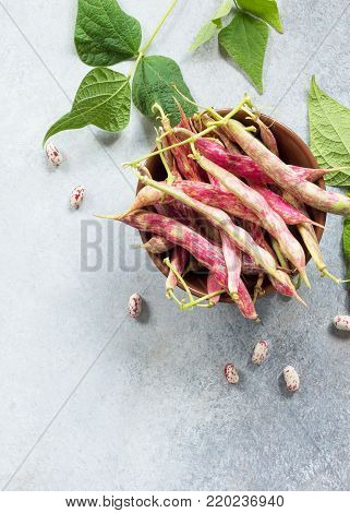 A Pod Of Green Beans And Beans. Red Beans On A Gray Slate Or Stone Background. Flat Lay. Top View Wi