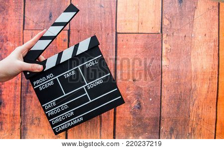 Clapper Plates, Women's Hands And Film Clapper On A Wooden Background