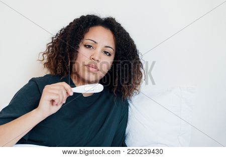 Woman Checking The Result Of Pregnancy Test