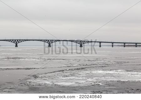 Bridge across the Volga river between the cities of Saratov and Engels. Ice on the river. Russia