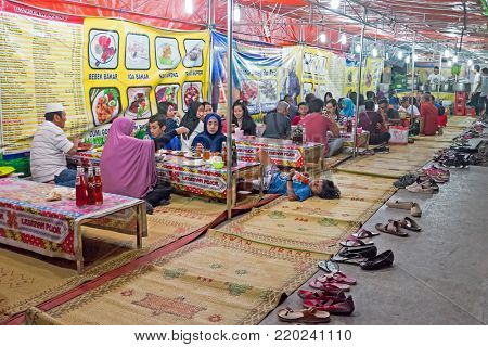 JAVA, INDONESIA - DECEMBER 16, 2016: People eating in a traditional restaurant on Java Indonesia 16th december 2016