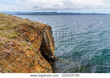 Cave in Cape Uyuga. Maloe More on Lake Baikal in the morning. Russia